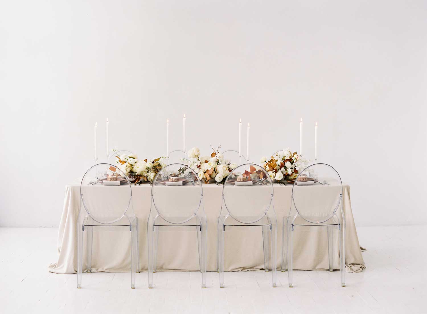 neutral holiday tablescape table ideas beige tan brown ghost chairs