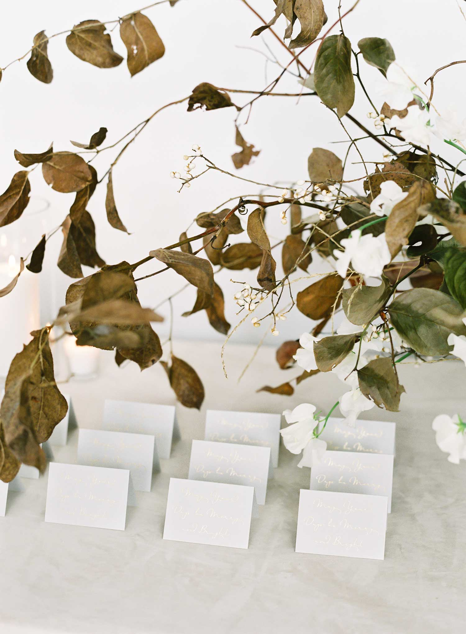 holiday entertaining party ideas light grey escort cards gold calligraphy