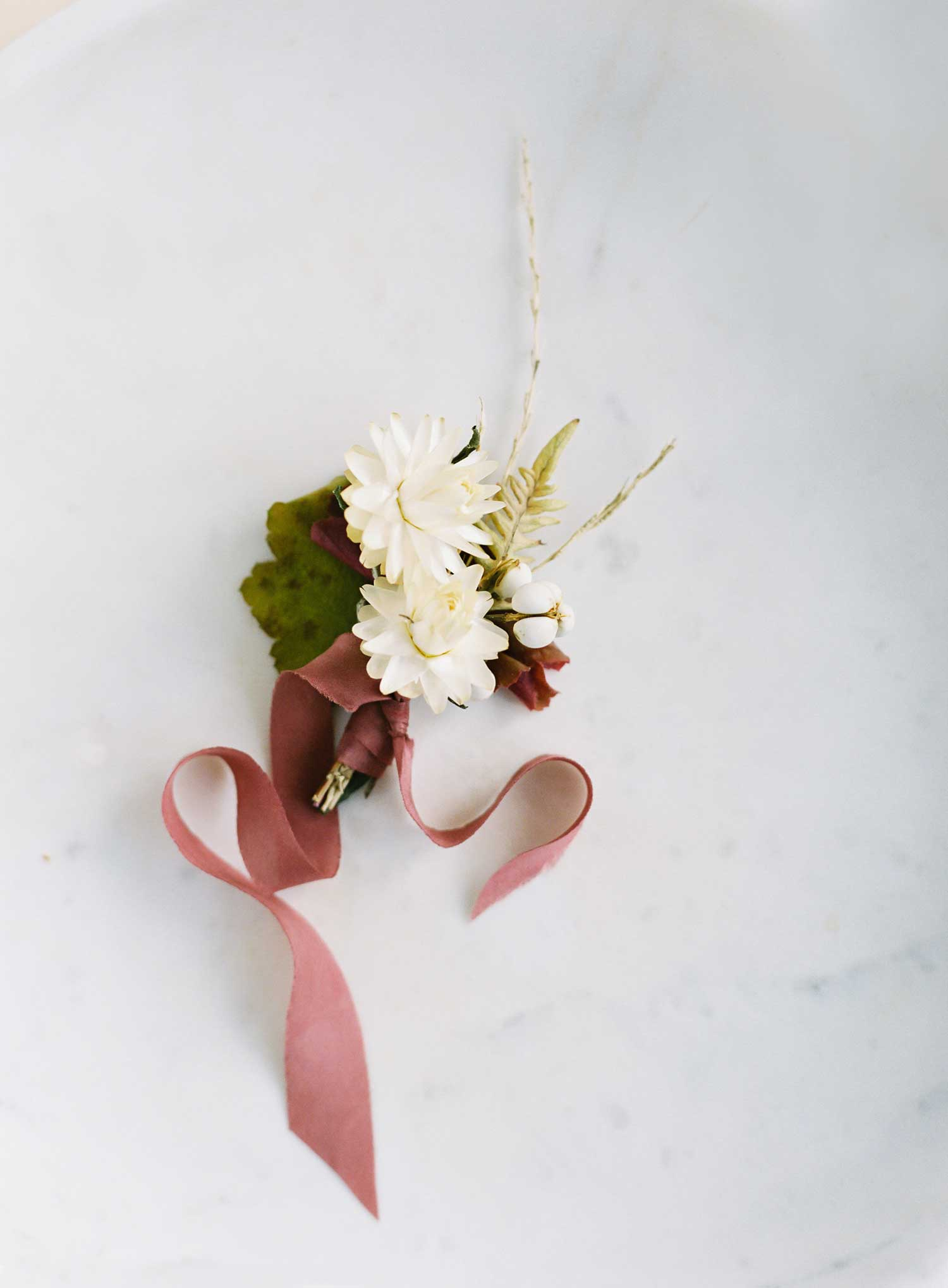 Holiday tabletop ideas wedding shoot with neutral holiday tablescape winter fall party entertaining ideas boutonniere
