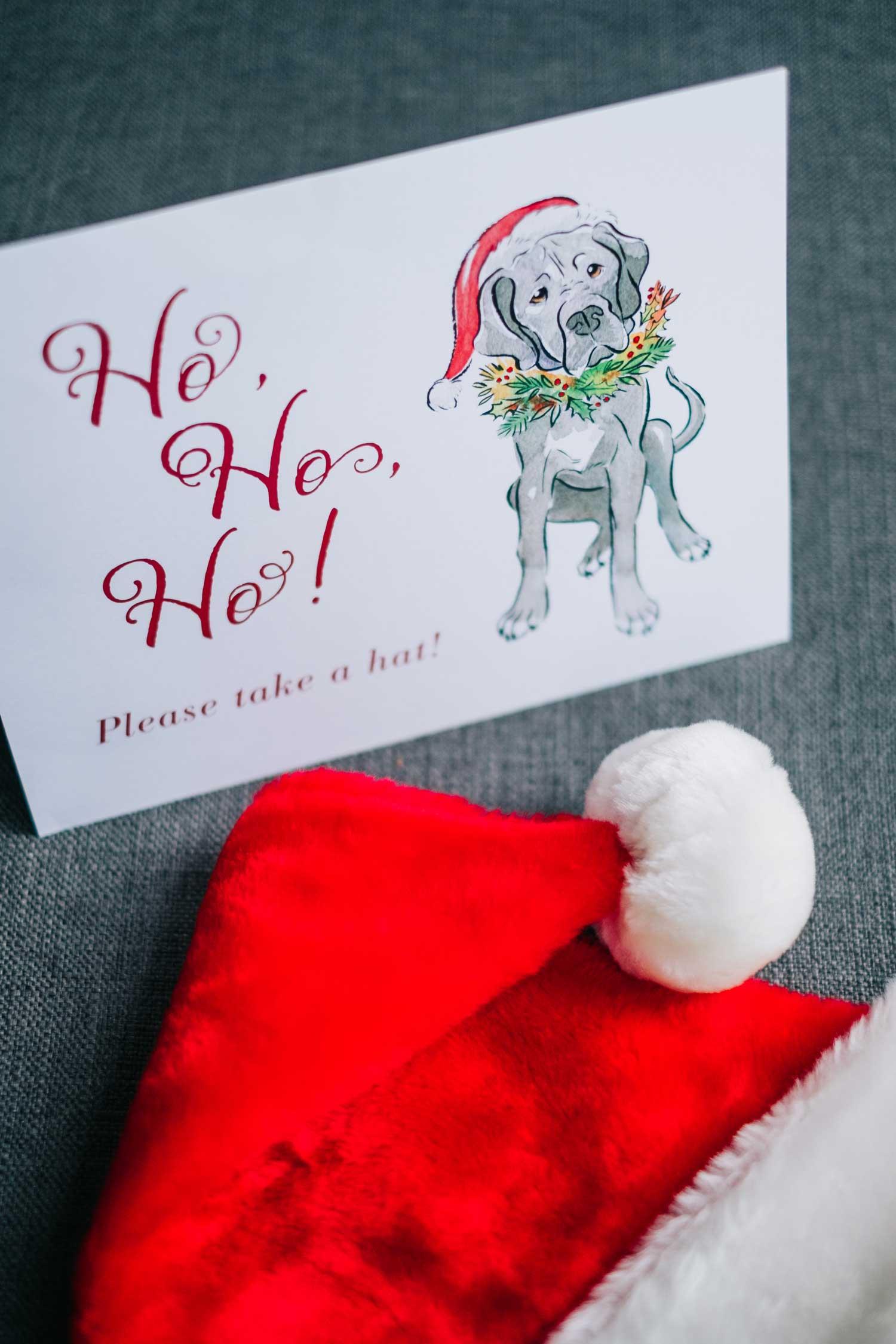 holiday wedding ideas santa hat favors with sign ho ho ho