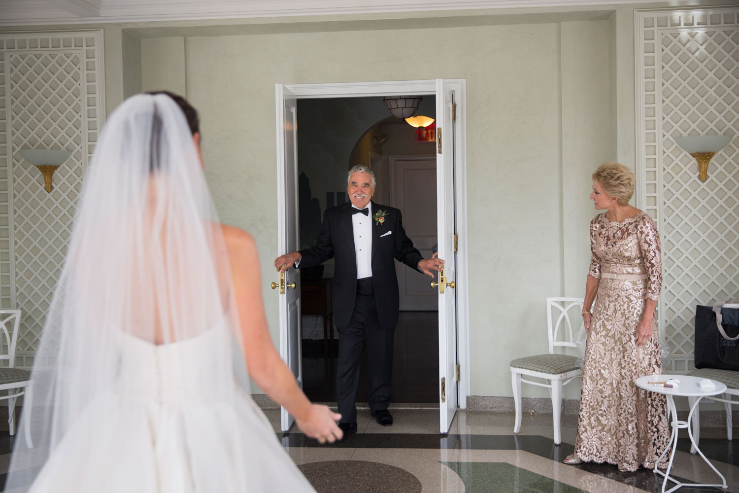 First look between bride mother of bride and father of bride the day by ira lippke