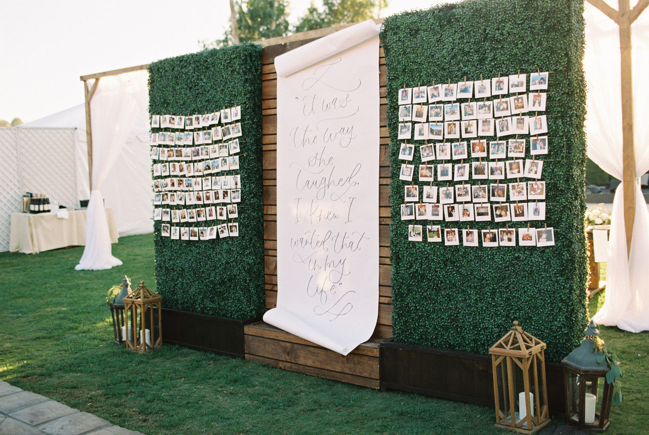 Seating chart with large quote calligraphy wall display everafter events