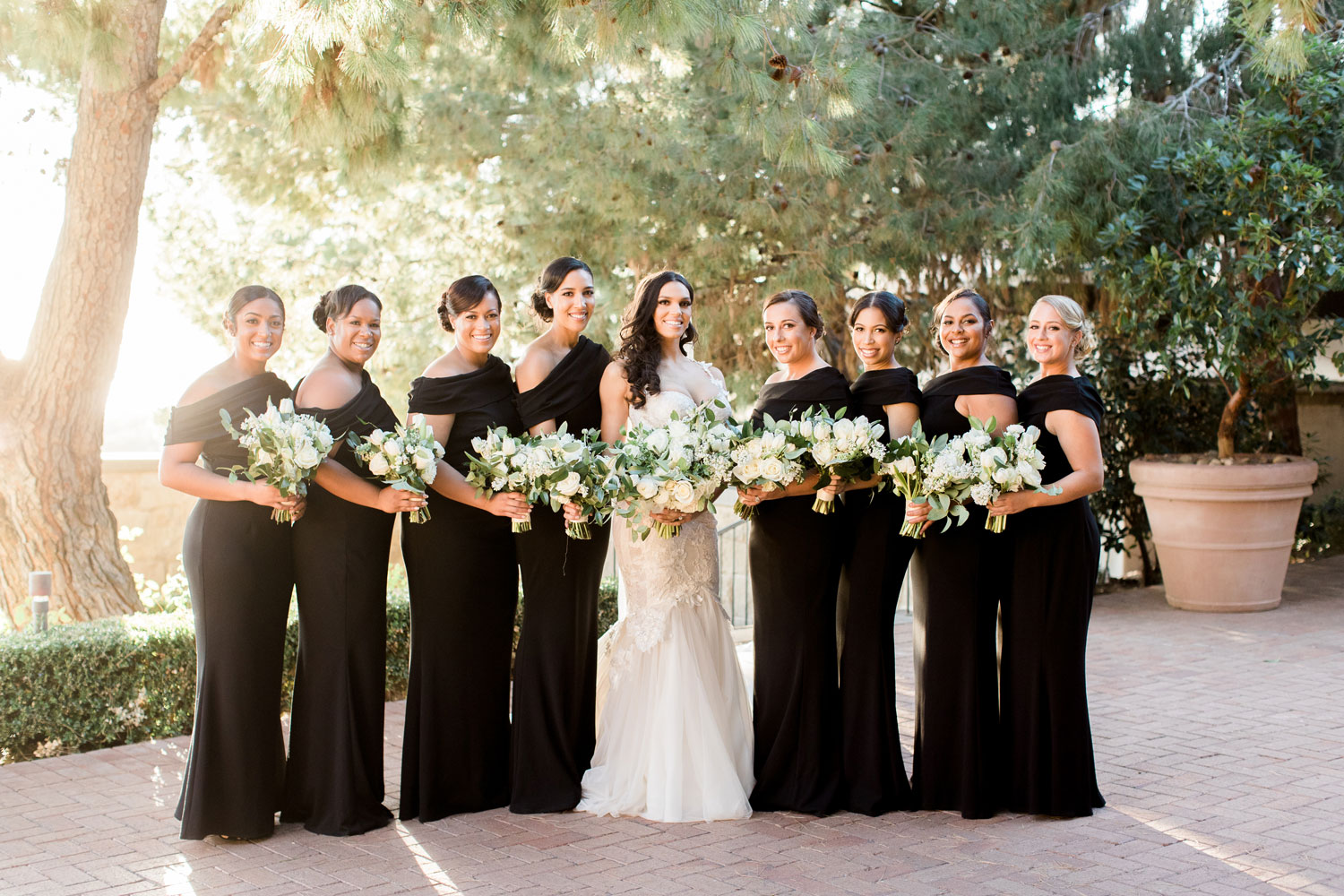 Charlise Castro in wedding dress styled by Maradee Wahl Dear Maradee with bridesmaids black dresses George Springer wedding