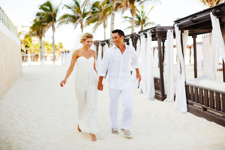 Hyatt Zilara Cancun Playa Resorts bride and groom holding hands on beach destination wedding