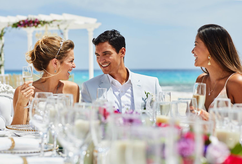 Hyatt Zilara Cancun Playa Resorts destination wedding reception on beach bride and groom with guests