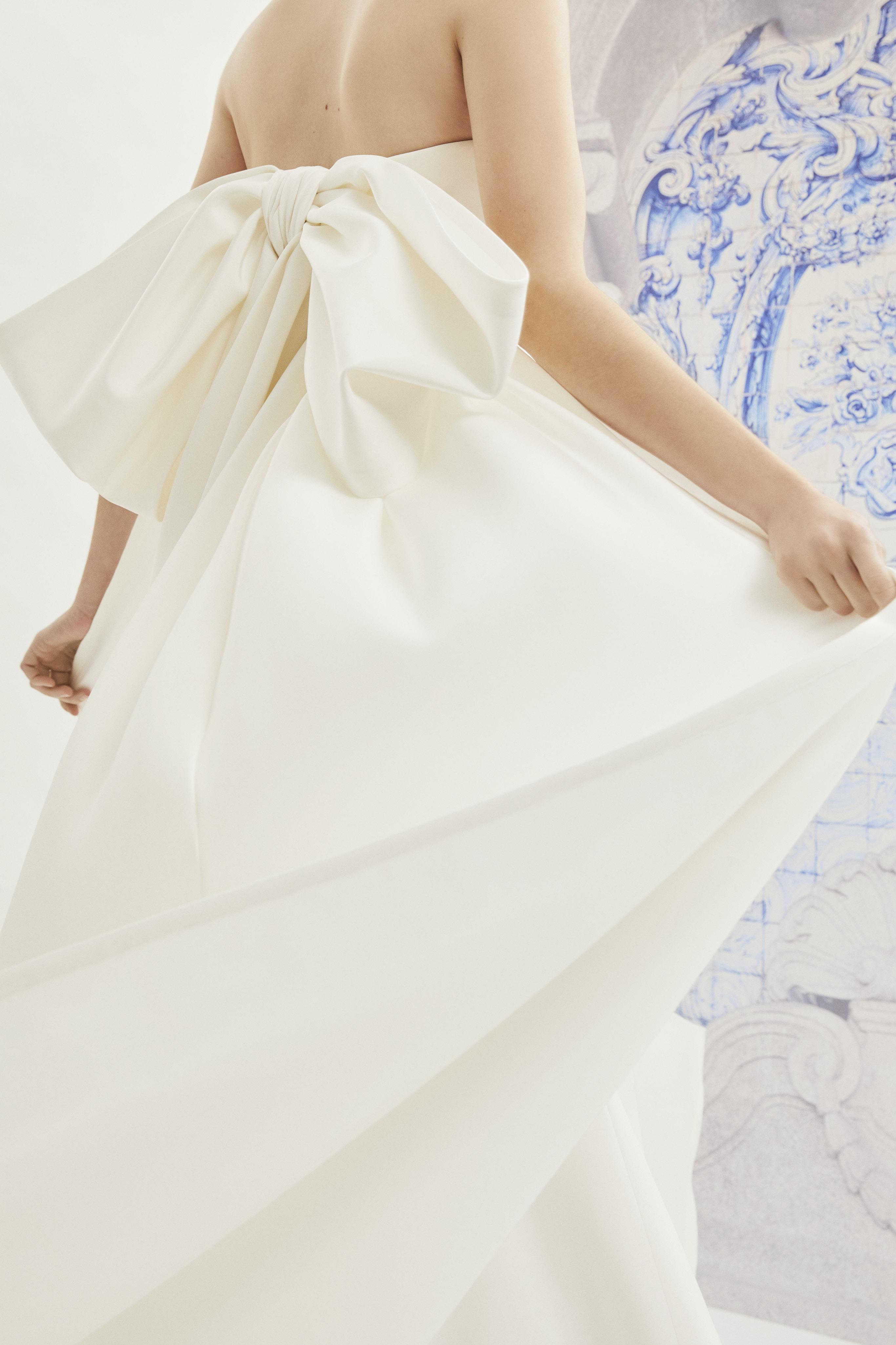 Carolina Herrera strapless wedding dress with large oversized bow in back