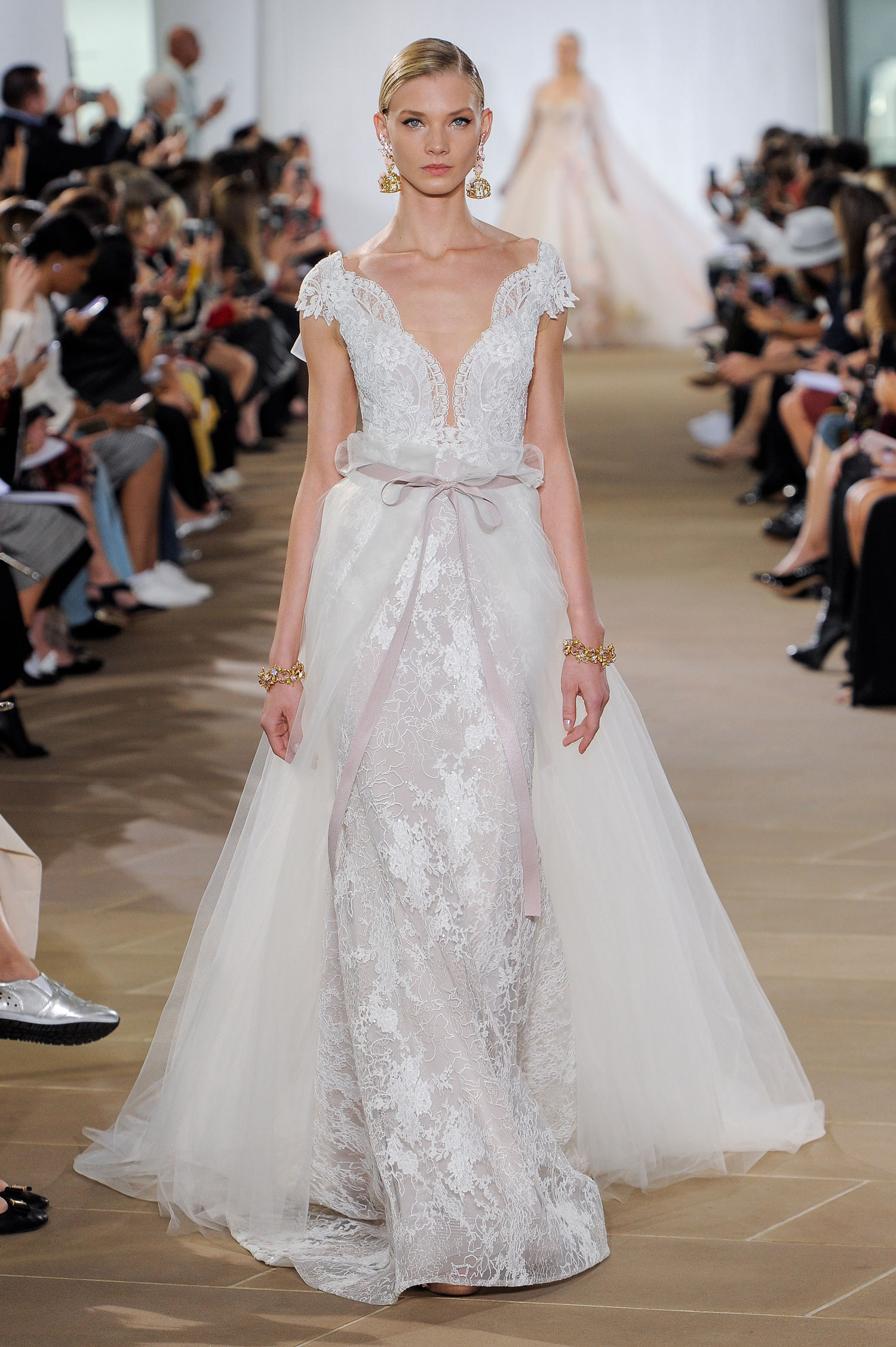 Ines Di Santo wedding dress with overskirt and pink bow detail in front