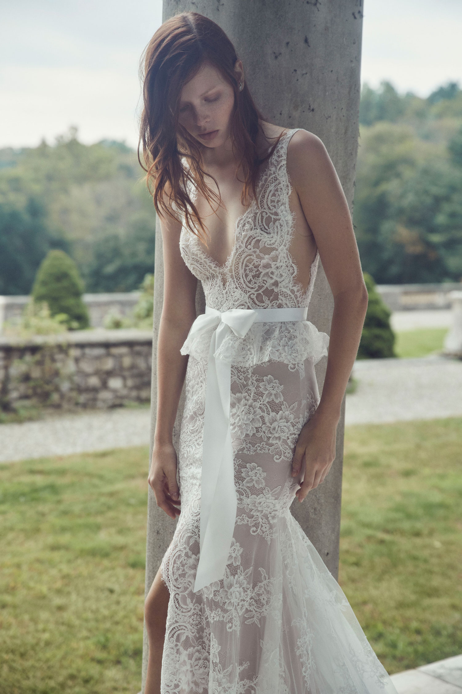 Monique Lhuillier wedding dress lace bridal gown with large bow in front