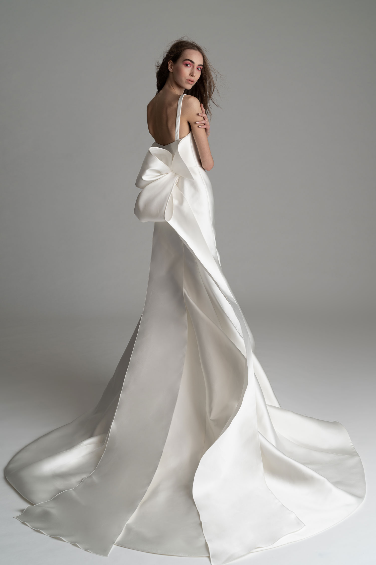 Rowling wedding dress by Rivini with large oversize bow in back