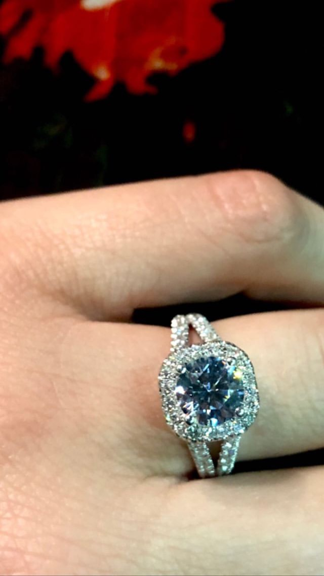 abbie cornish engagement ring, round diamond in cushion halo split-shank pavé setting