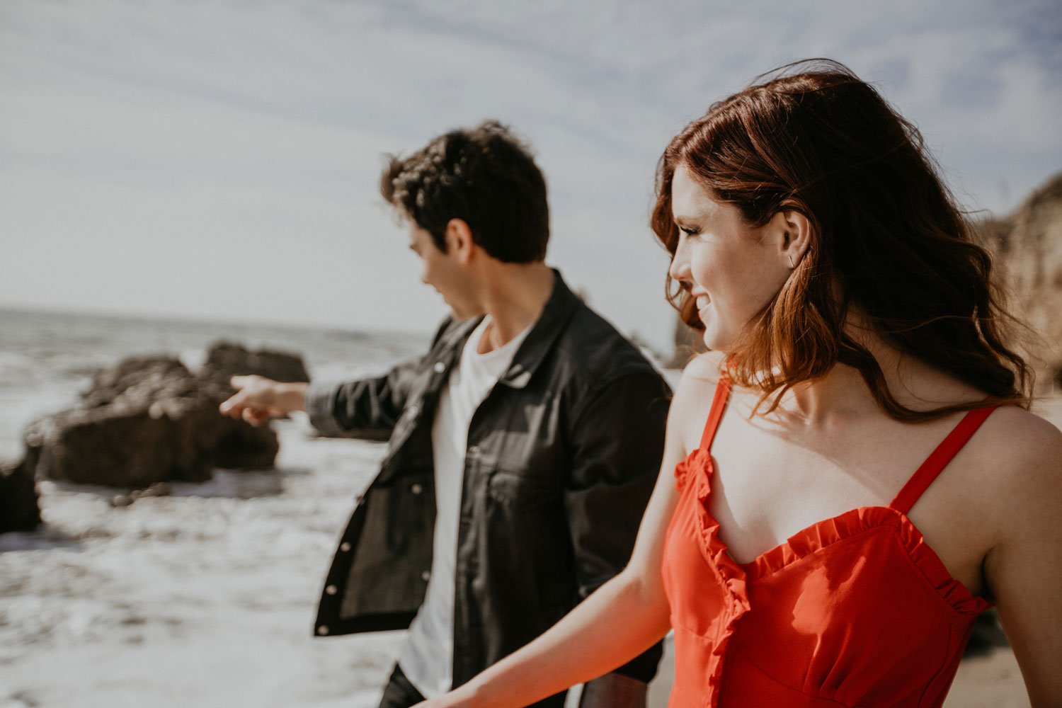 Echosmith Sydney Sierota in red dress and Allstar Weekend Cameron Quiseng engagement shoot on Malibu beach