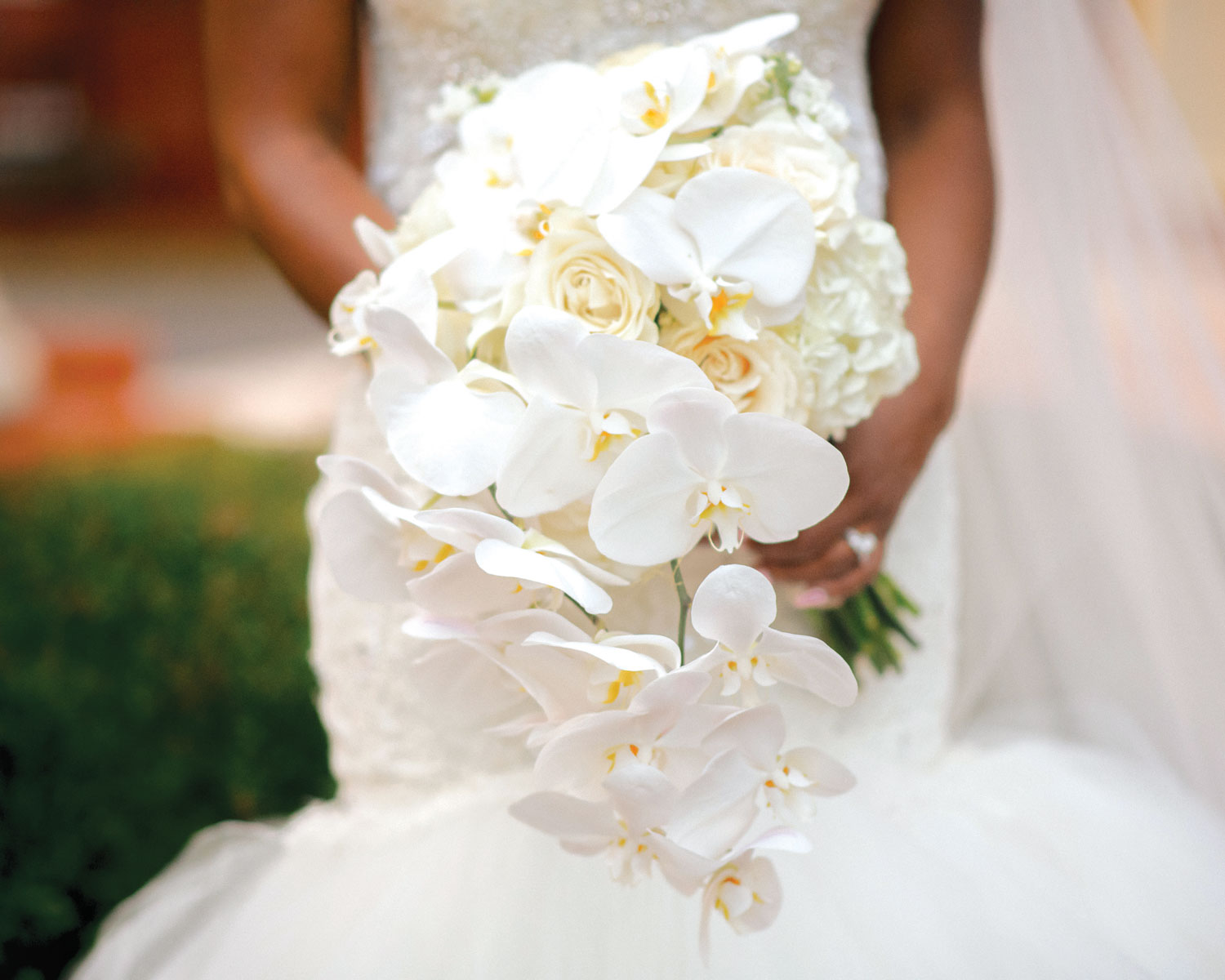 Inside Weddings magazine Spring 2019 issue wedding bouquet orchids white flowers