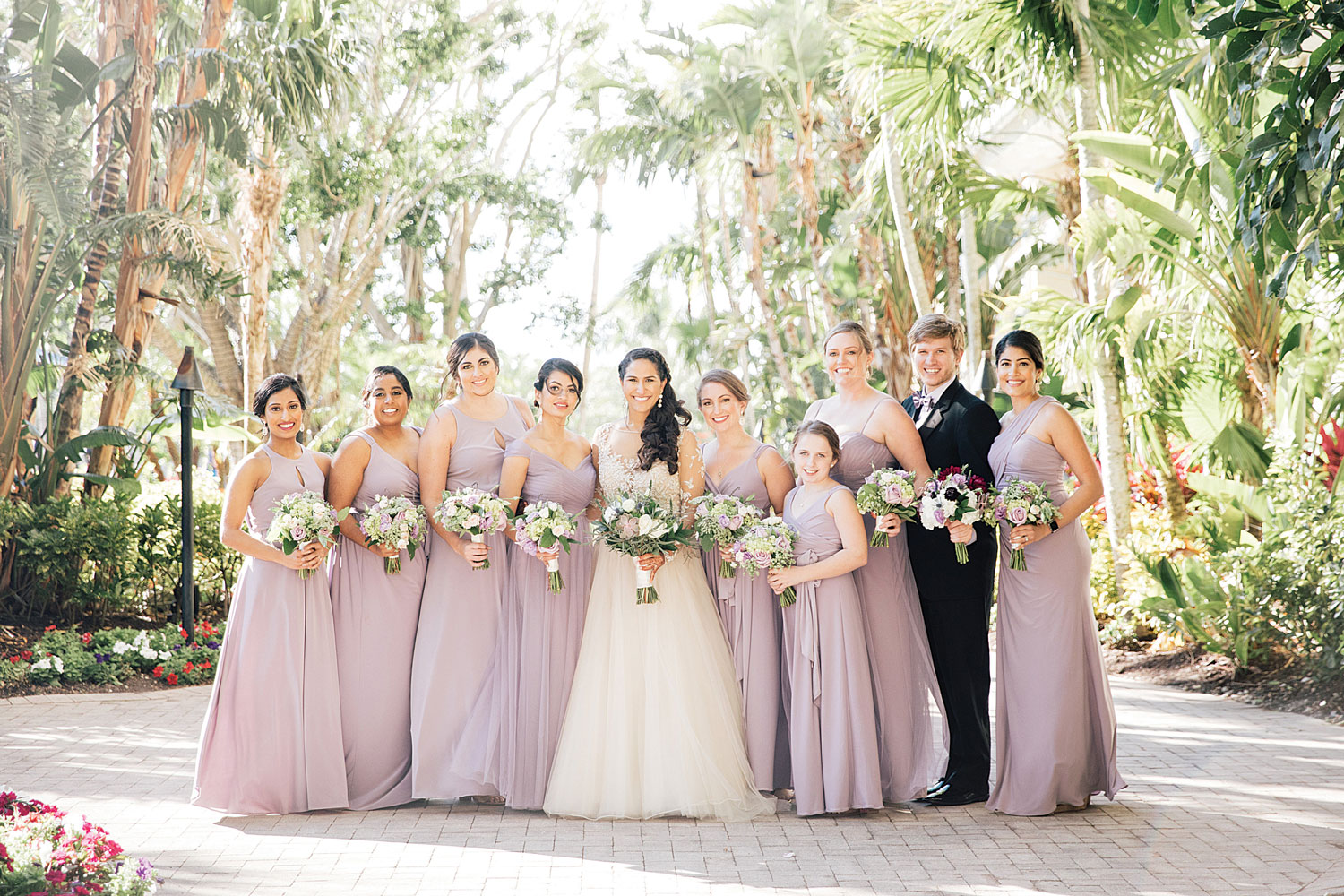 Inside Weddings magazine Spring 2019 issue wedding party bridesmaids in purple lavender dresses