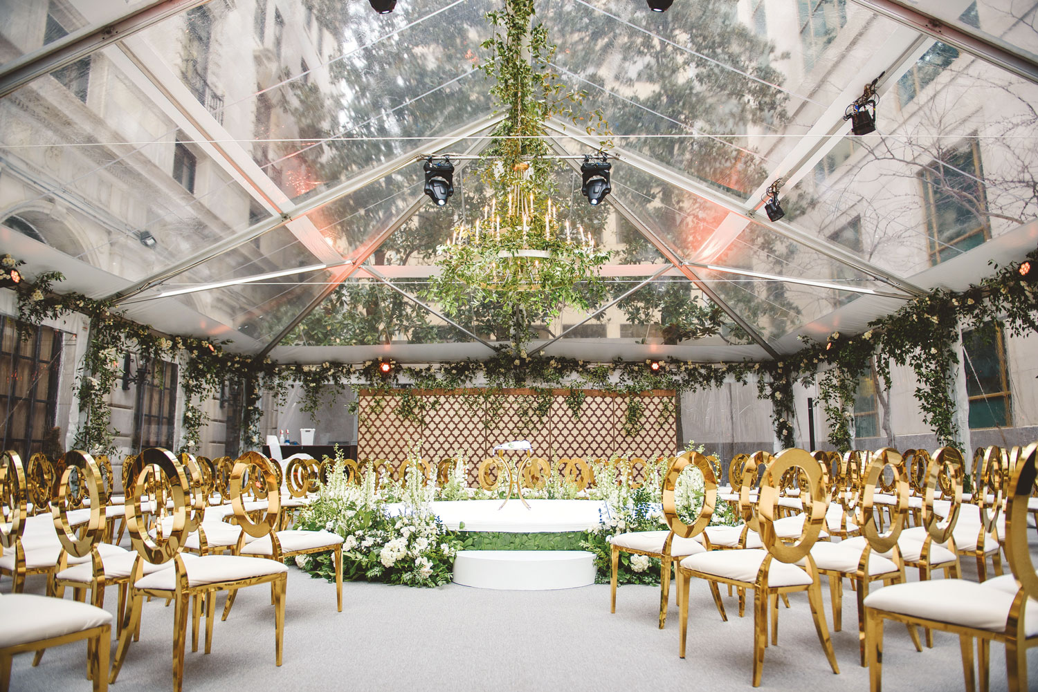 Inside Weddings magazine Spring 2019 issue pretty tented wedding ceremony greenery gold chairs