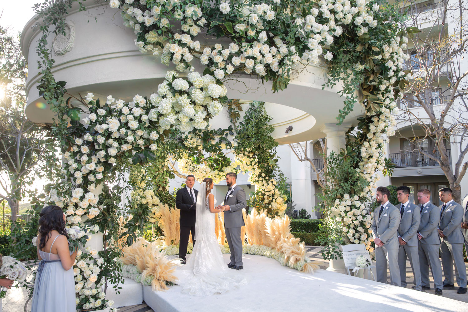 Inside Weddings magazine Spring 2019 issue outdoor wedding ceremony with flowers and pampas grass
