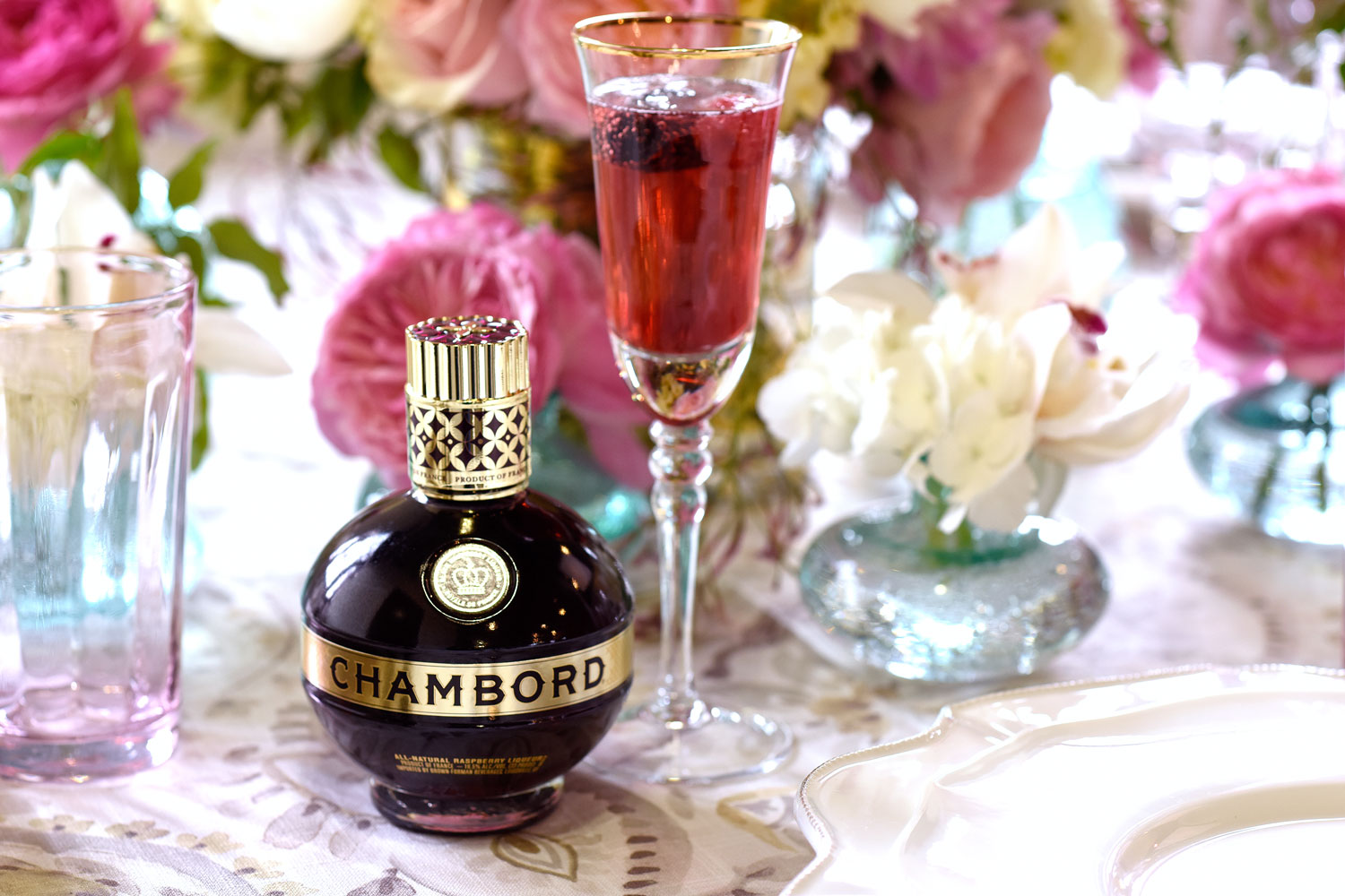 Chambord Royale cocktail recipe with champagne and raspberry garnish