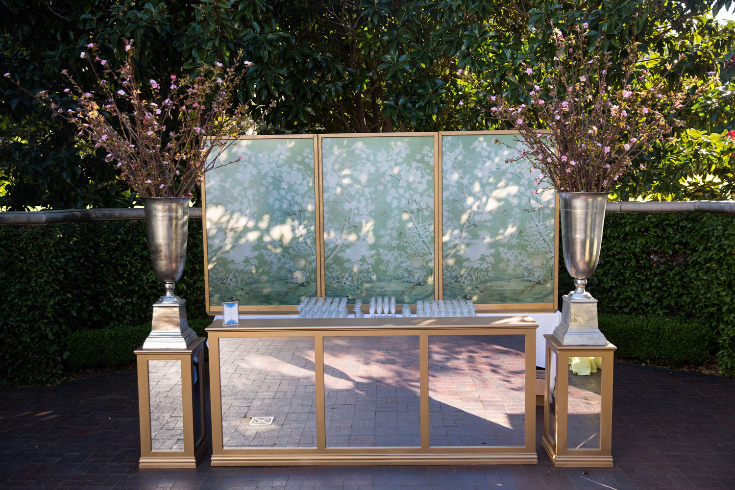 outdoor wedding bar with gold mirror panels and hand painted design emily clarke events