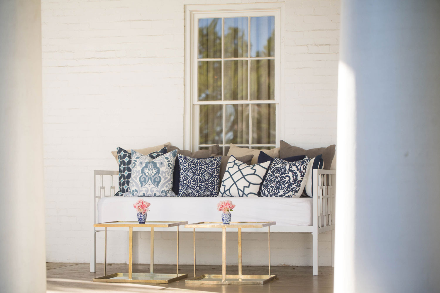 outdoor wedding lounge area on porch patio blue and white pillows emily clarke events