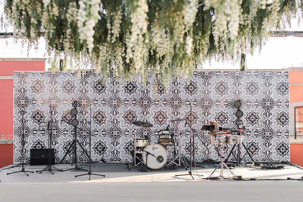 Pretty stage backdrop for live band at wedding reception outdoor flower chandelier pattern emily clarke events