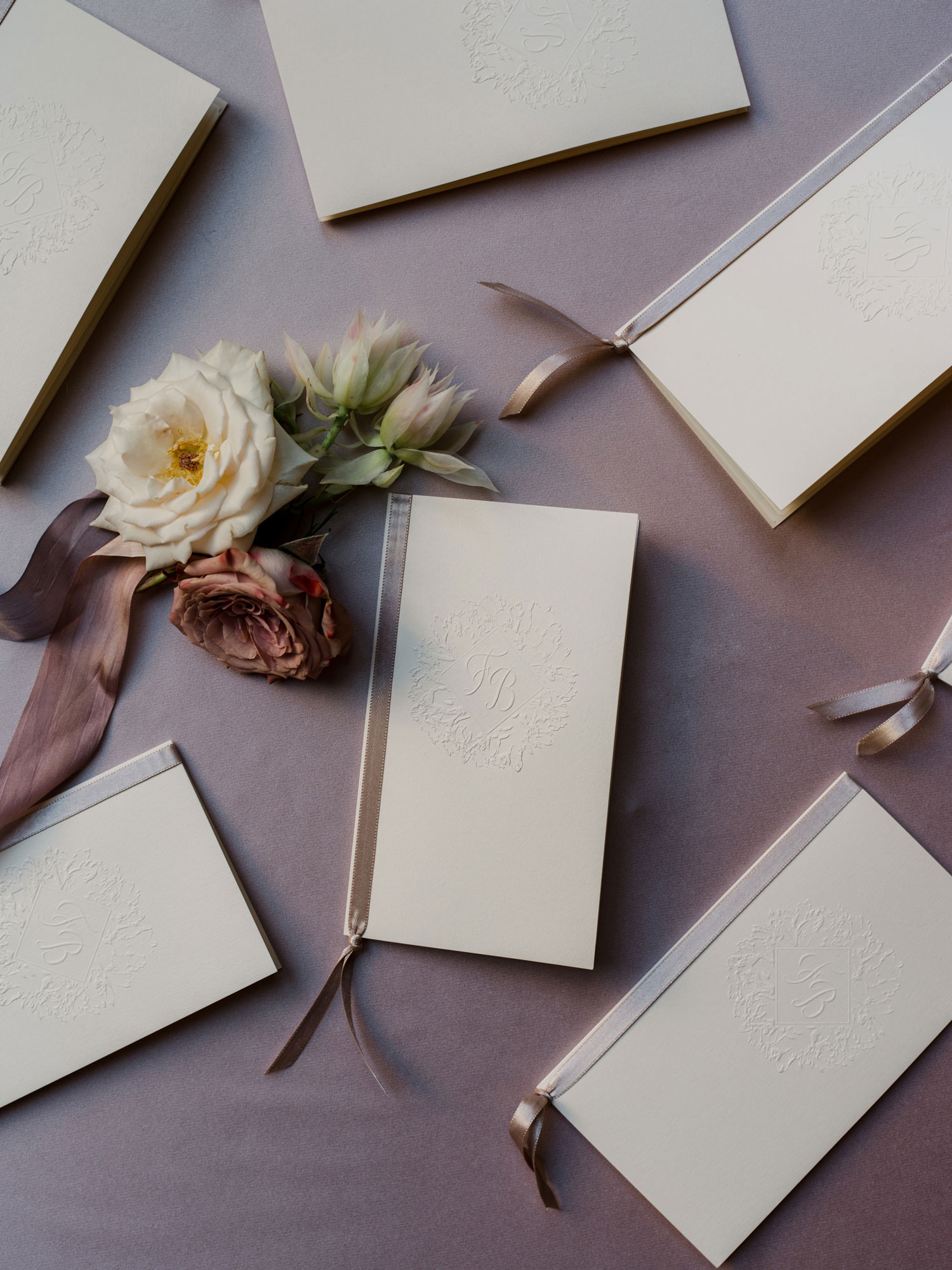 pretty wedding ceremony program booklets with satin ribbon binding