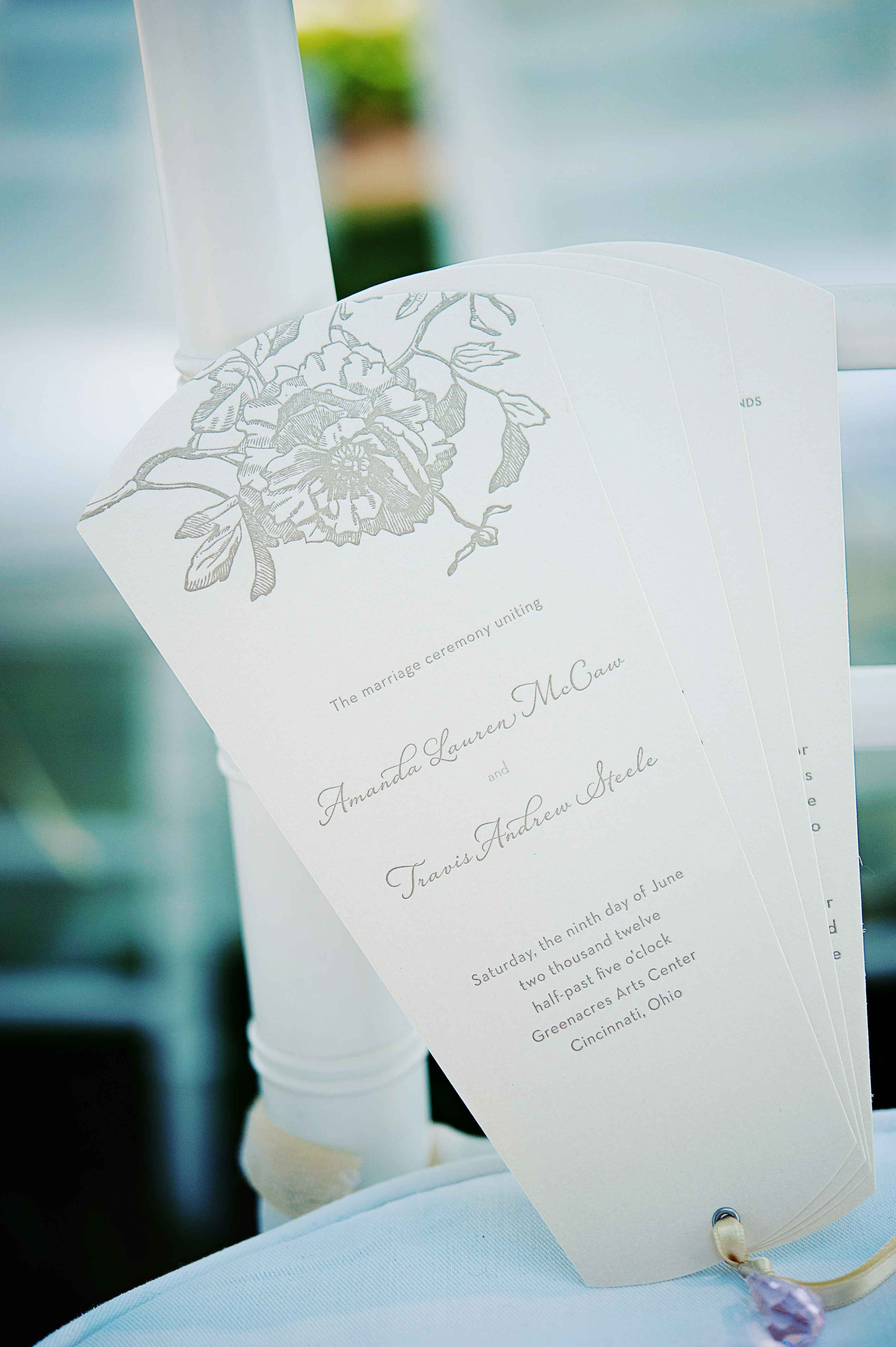 wedding ceremony fan program with grey silver lettering on ceremony chair classic