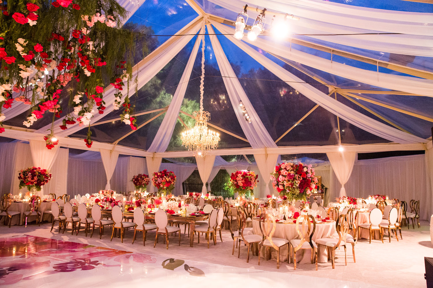 pretty wedding reception with clear top tent pink flowers