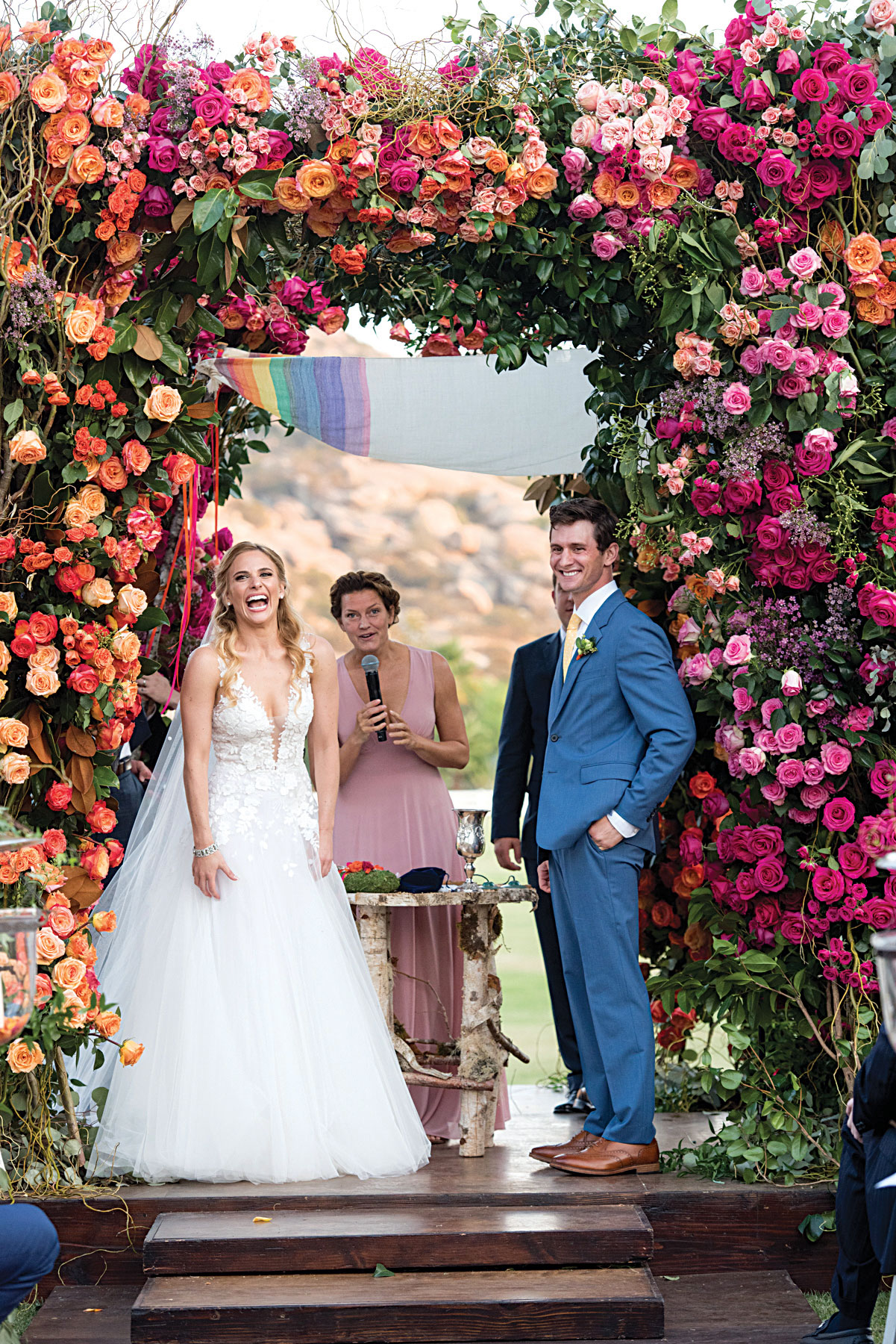 colorful wedding ceremony with flower chuppah ombre pink and orange flowers