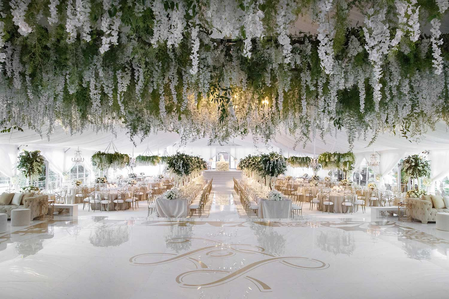 wedding reception white gold decor with pretty greenery ceiling installation over dance floor