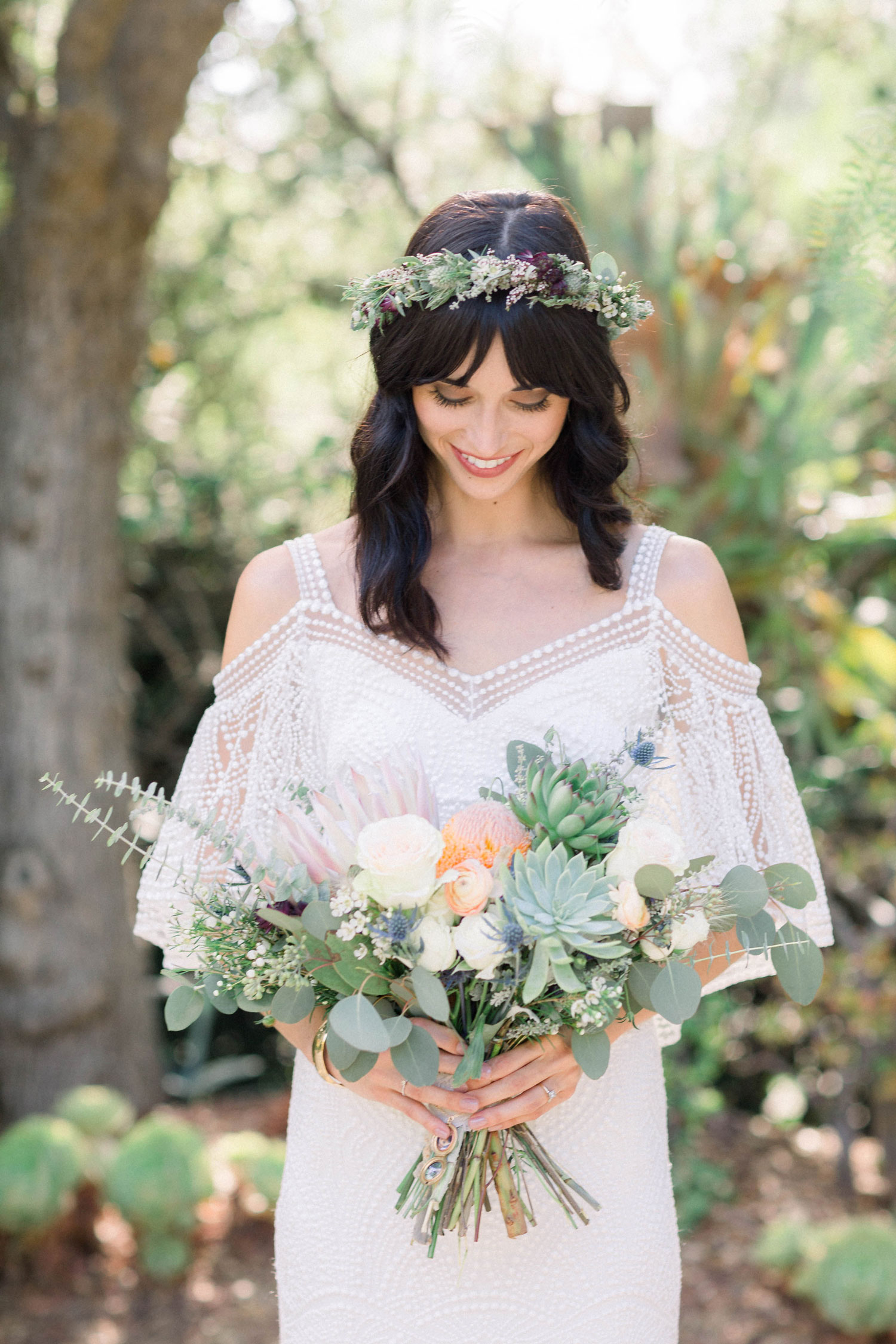 Bride for vegan wedding with flower crown and beautiful bouquet