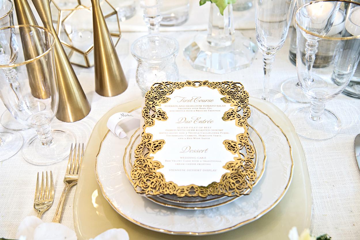 ornate white and gold laser cut wedding menu card