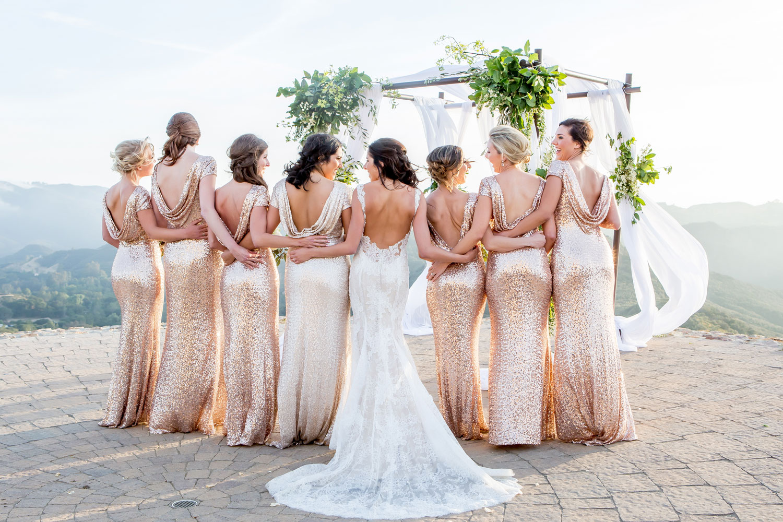 bride with bridesmaids in gold sequin bridesmaid dresses
