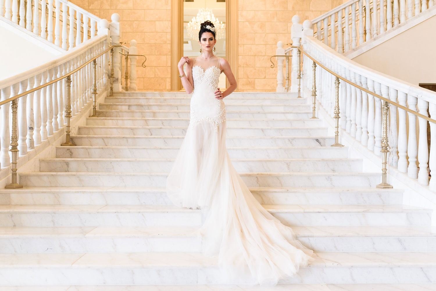 bride in pretty wedding dress on stairs gold white decor