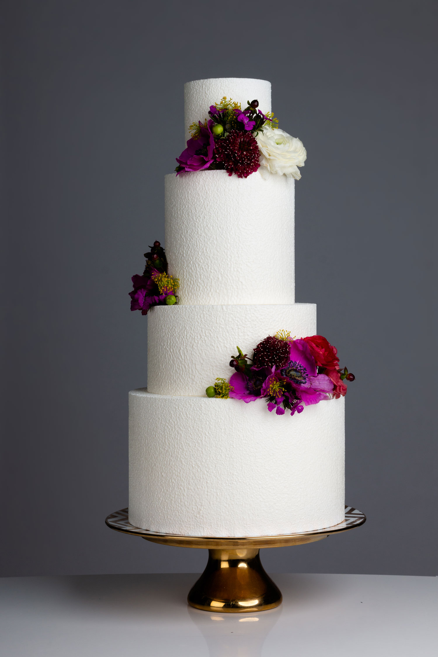 white chocolate cake with velvet texture and tropical flowers