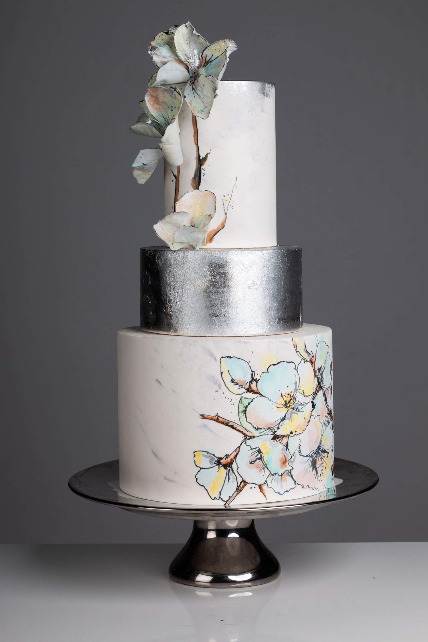 silver flower wedding cake with hand painted details and silver leaf