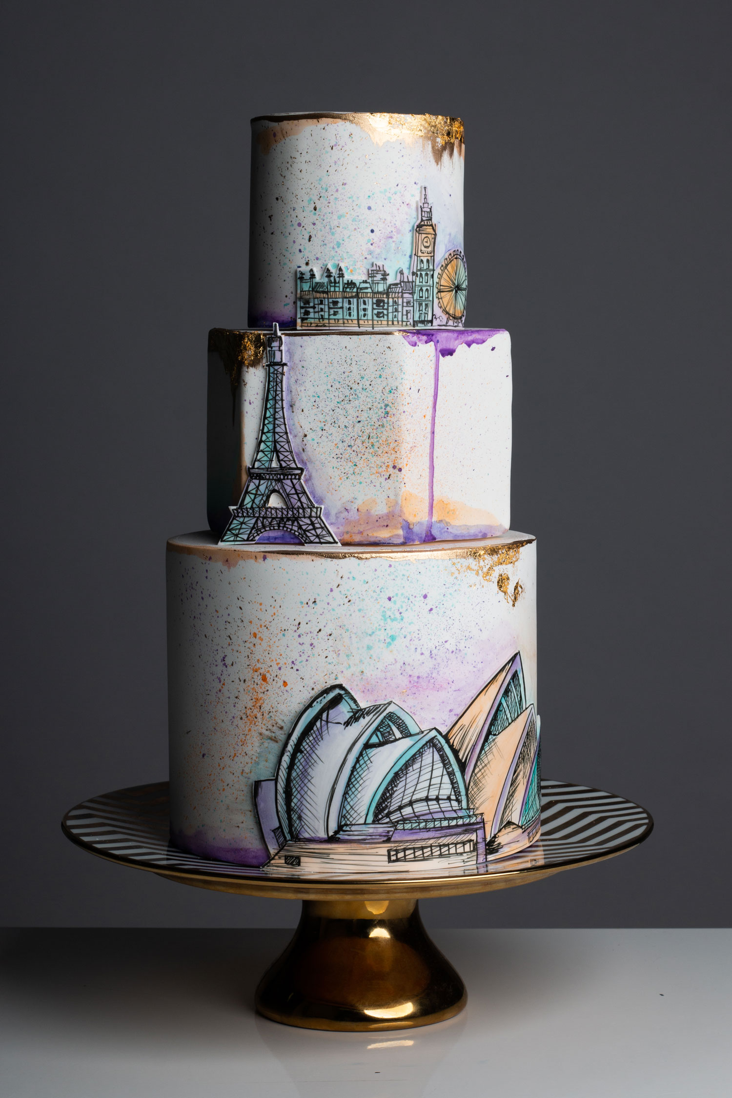 wedding cake with paris london and sydney design motifs