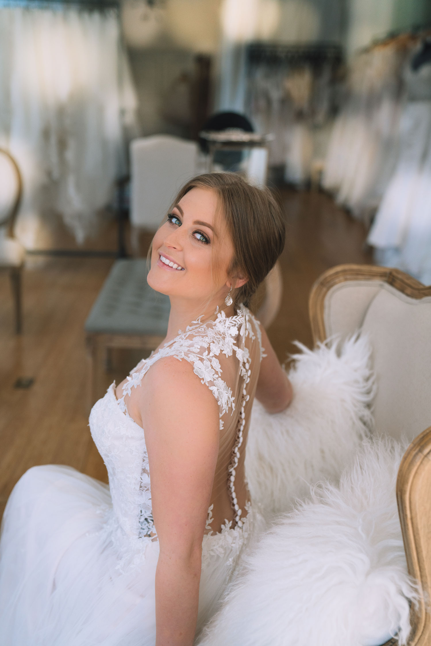 bride in pretty wedding dress with illusion back buttons and lace the boutique by bbelle events