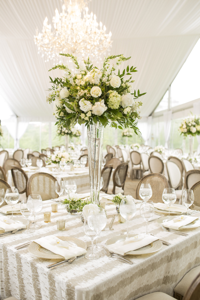 tall white rose and greenery flower arrangement on table wedding ideas