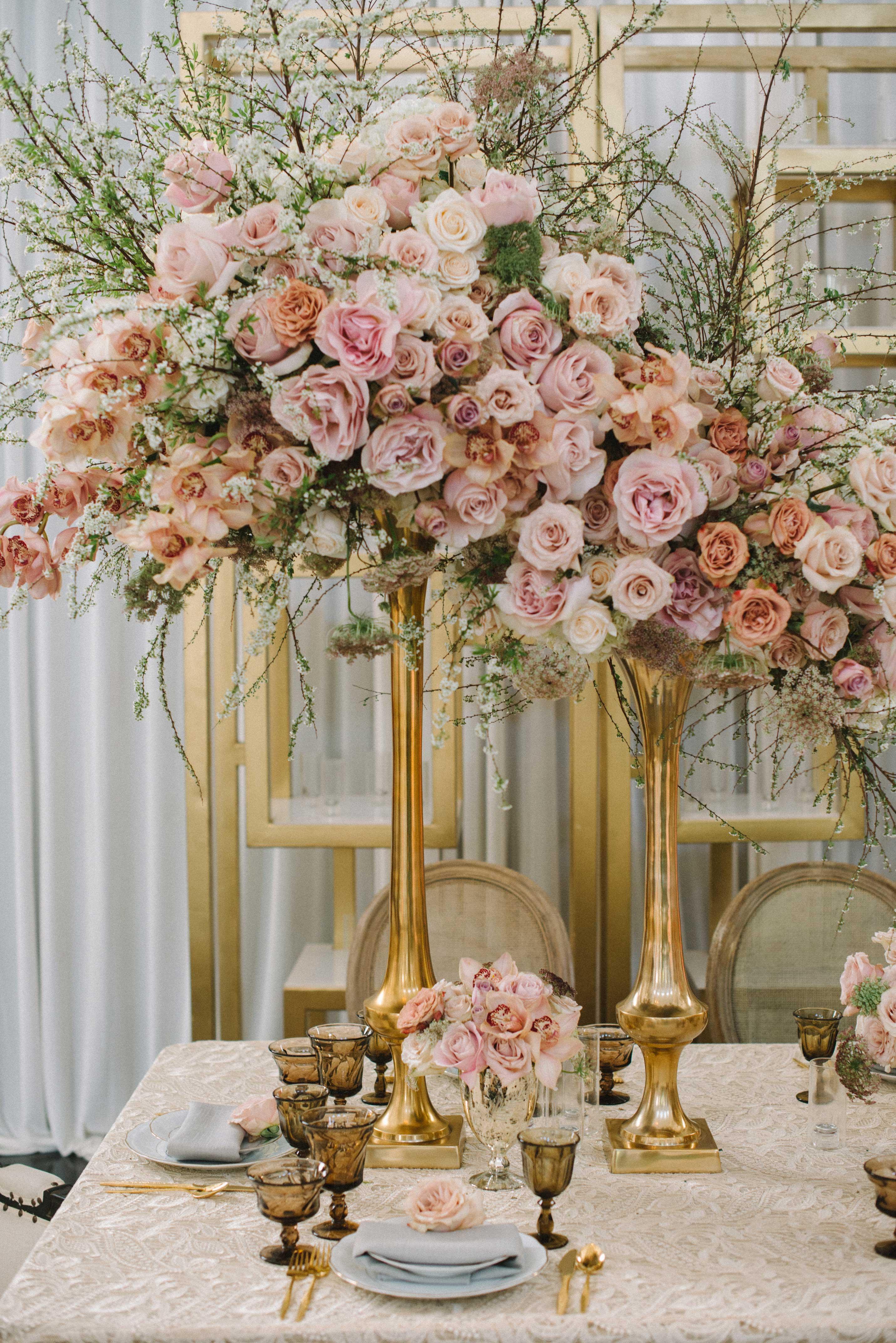 pink rose orchid branches tall centerpiece gold riser flower arrangement ideas wedding