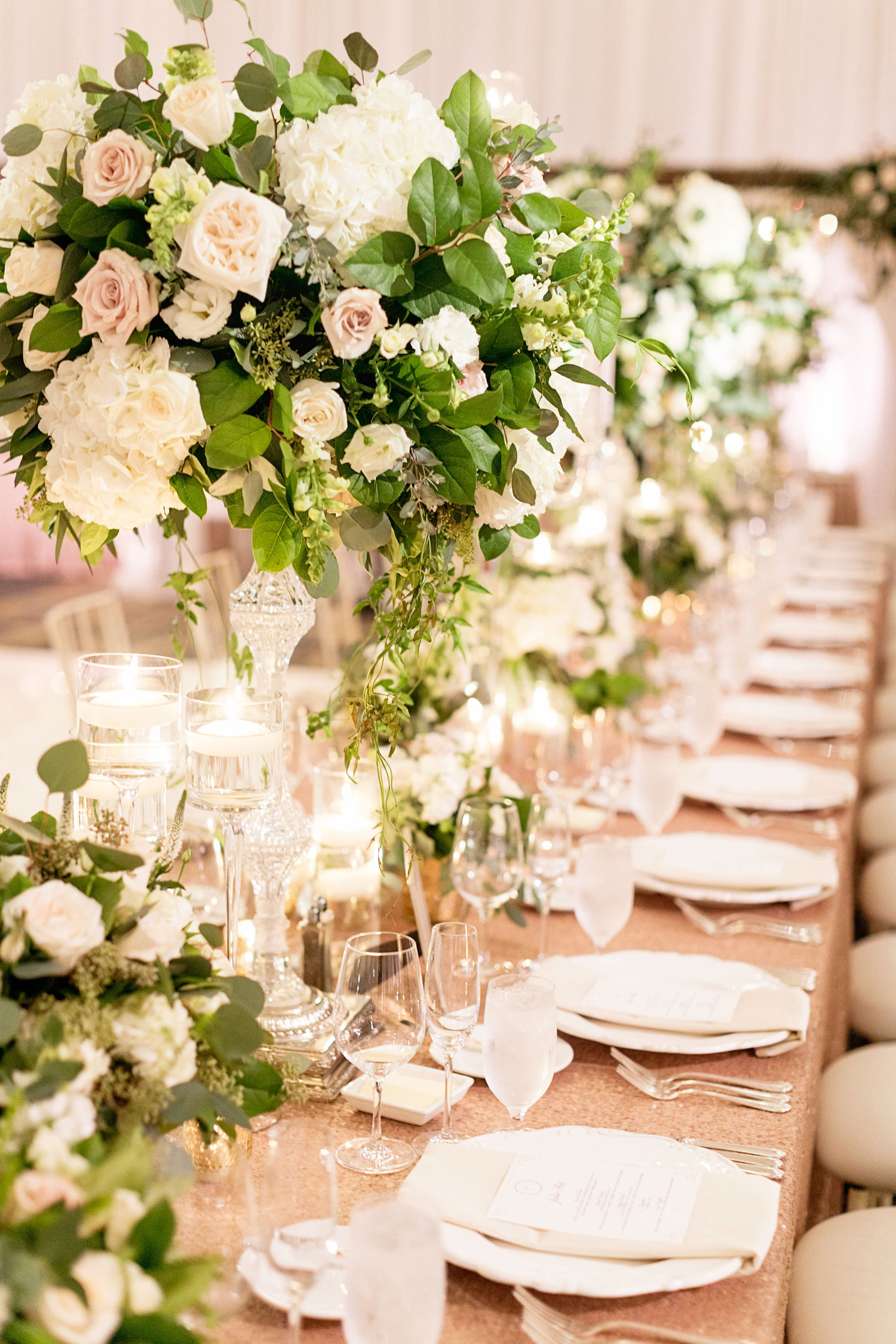 alternating high and low centerpiece tall white pink rose greenery flower ideas