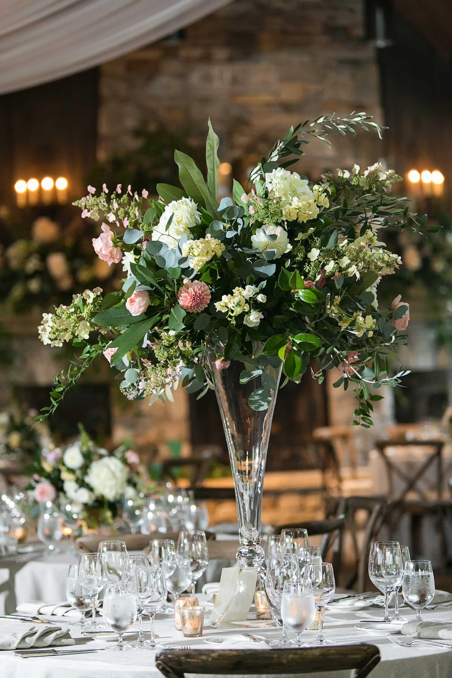 rustic wedding centerpiece greenery pink dahlia white flower tall centerpiece