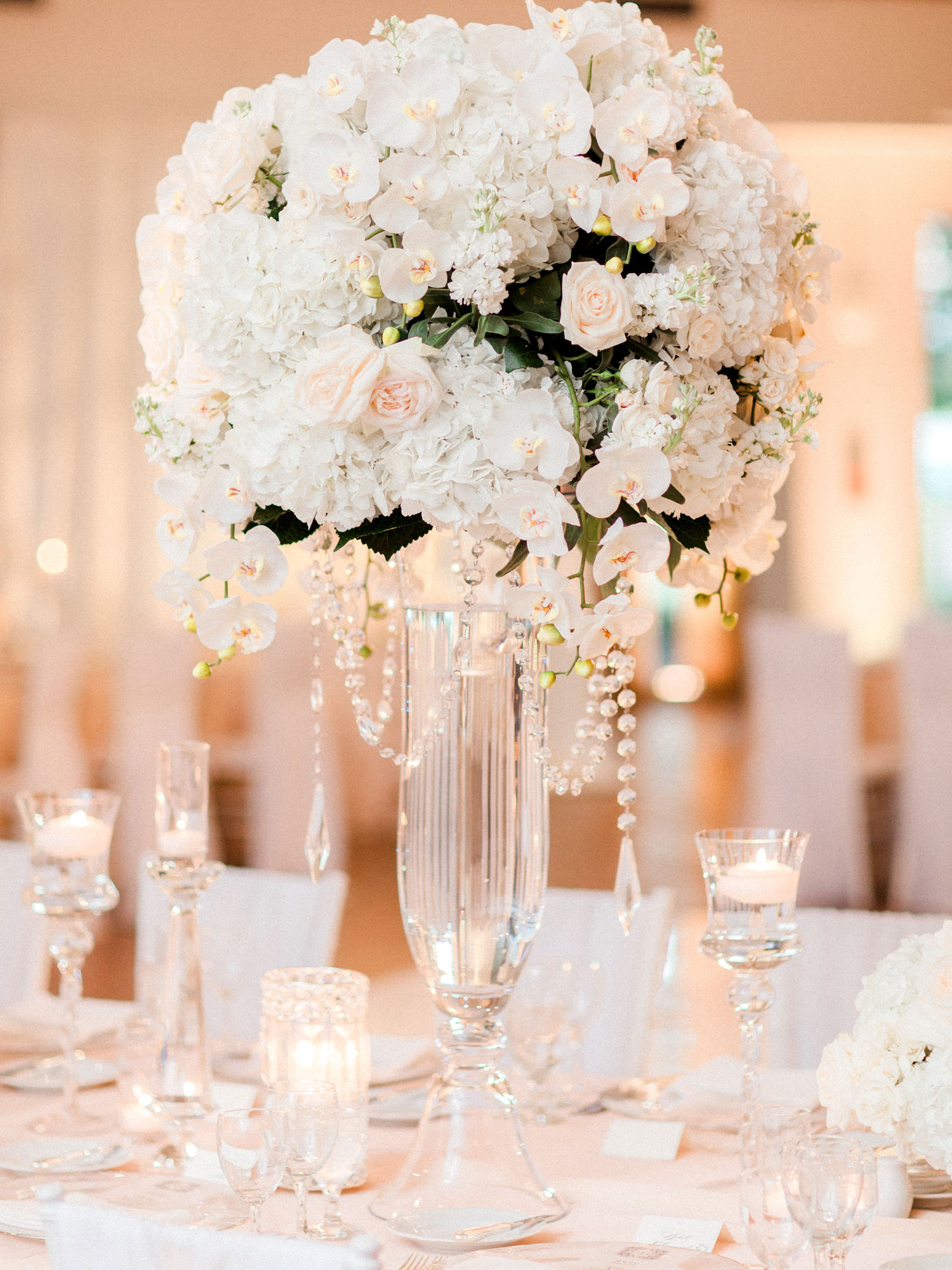 white orchid rose hydrangea crystal strand tall centerpiece wedding ideas