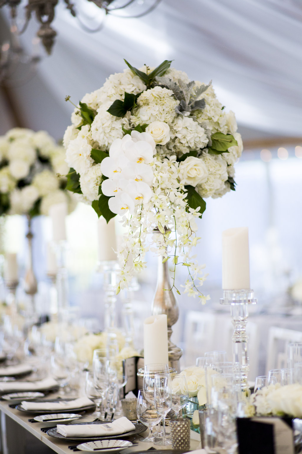 silver mercury glass stand white rose orchid hydrangea greenery flower arrangement tall centerpiece ideas