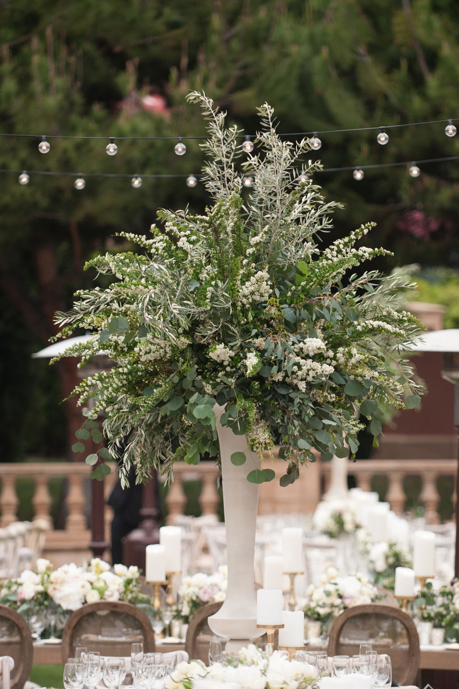 tall white vase with greenery centerpiece ideas tall flower arrangement