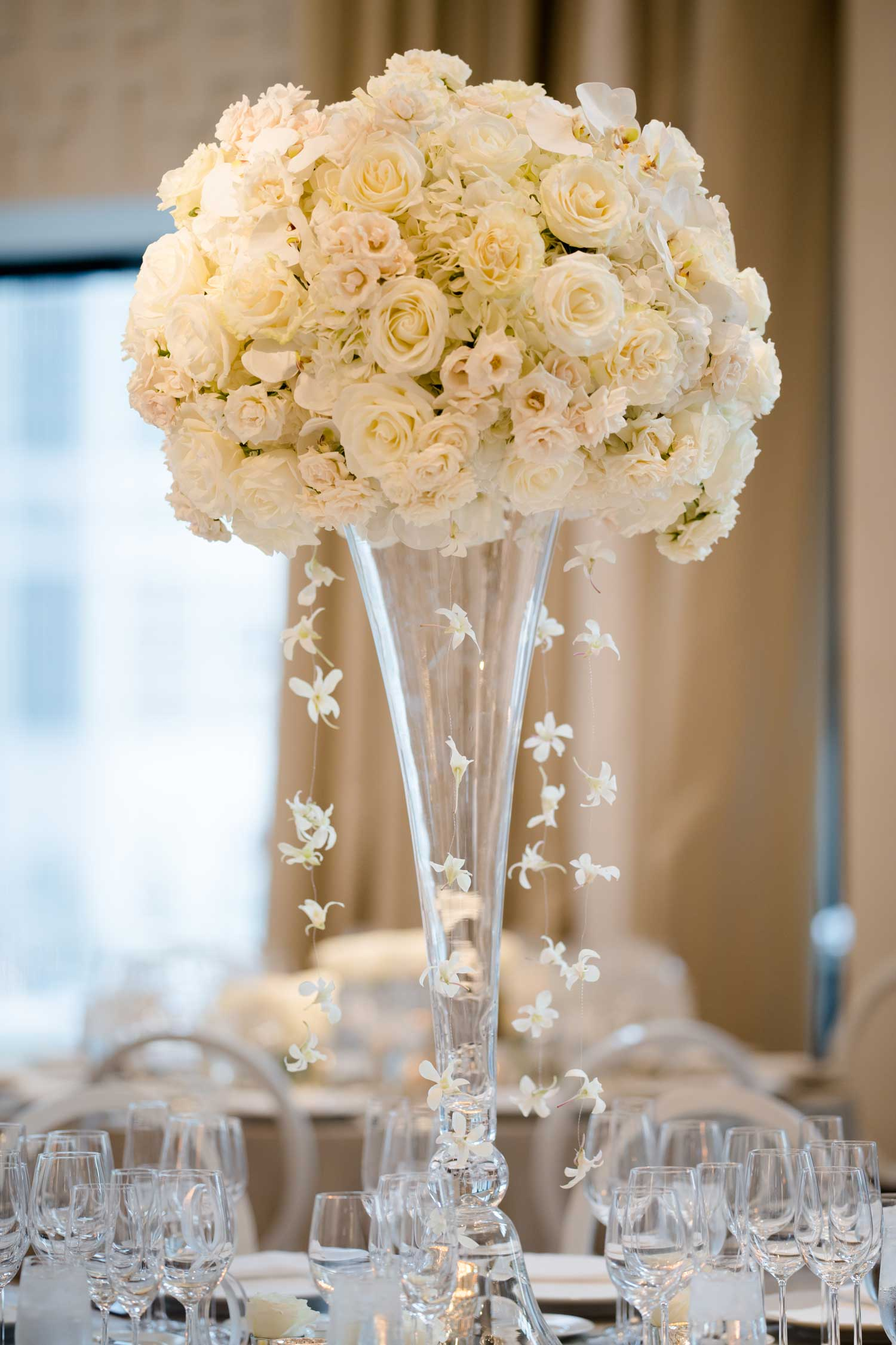 white rose and hydrangea flower centerpiece cascading orchid strands tall centerpiece ideas wedding