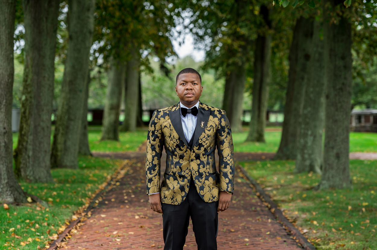 groom with black and gold jacquard pattern jacket groom style ideas
