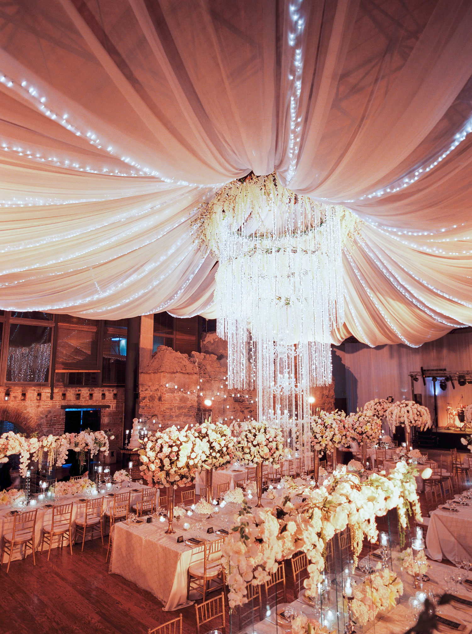 destination wedding reception guatemala with luxurious drapery from ceiling beams