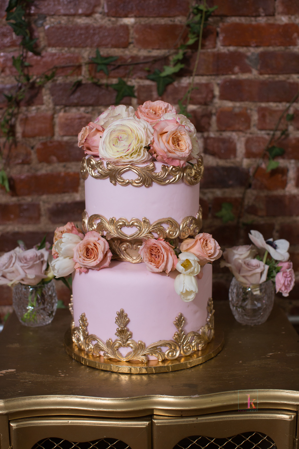 pink fondant wedding cake small two tier with gold embellishments fresh flowers