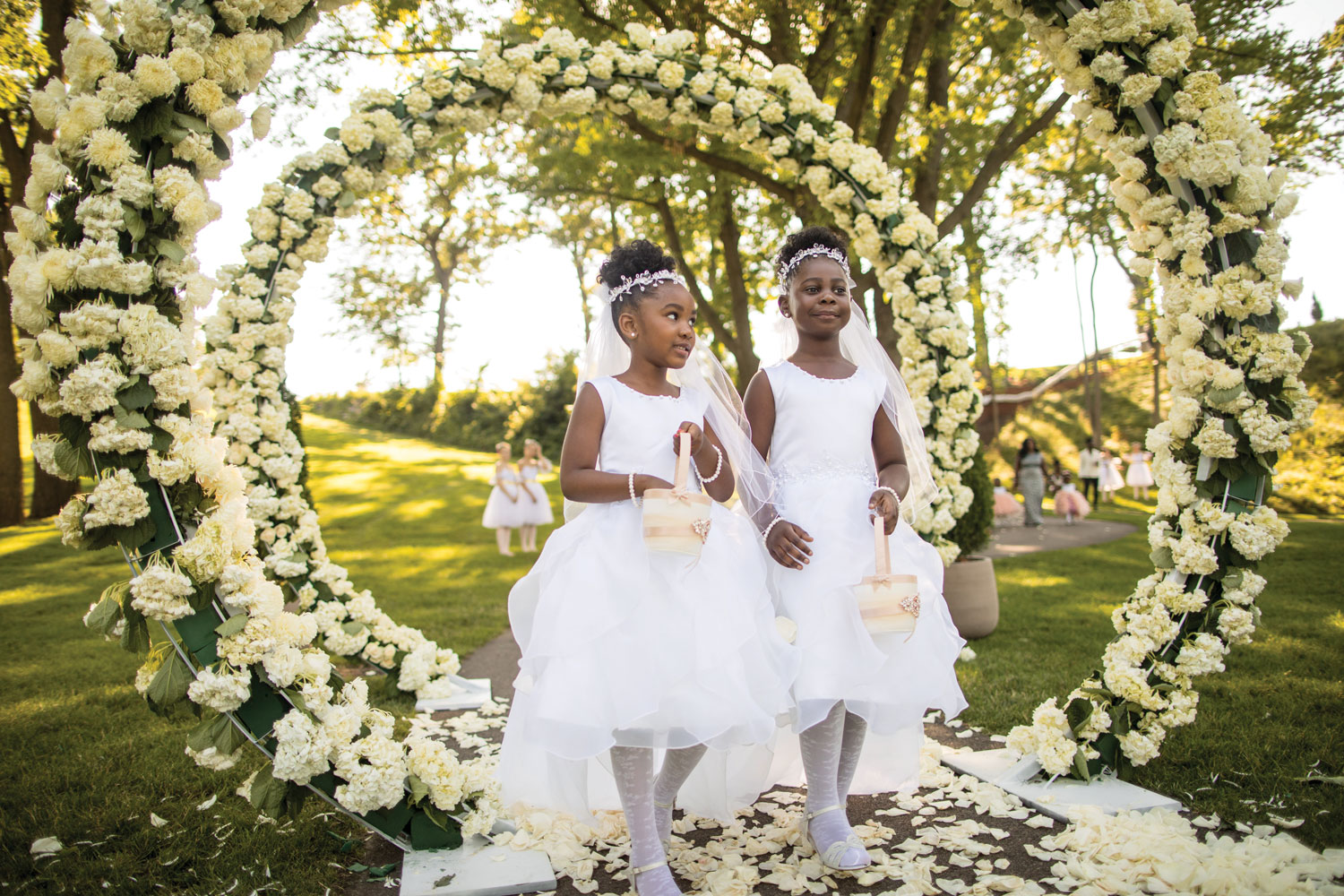 Inside Weddings magazine summer 2019 issue preview outdoor wedding ceremony african royalty flower girls white flower arches