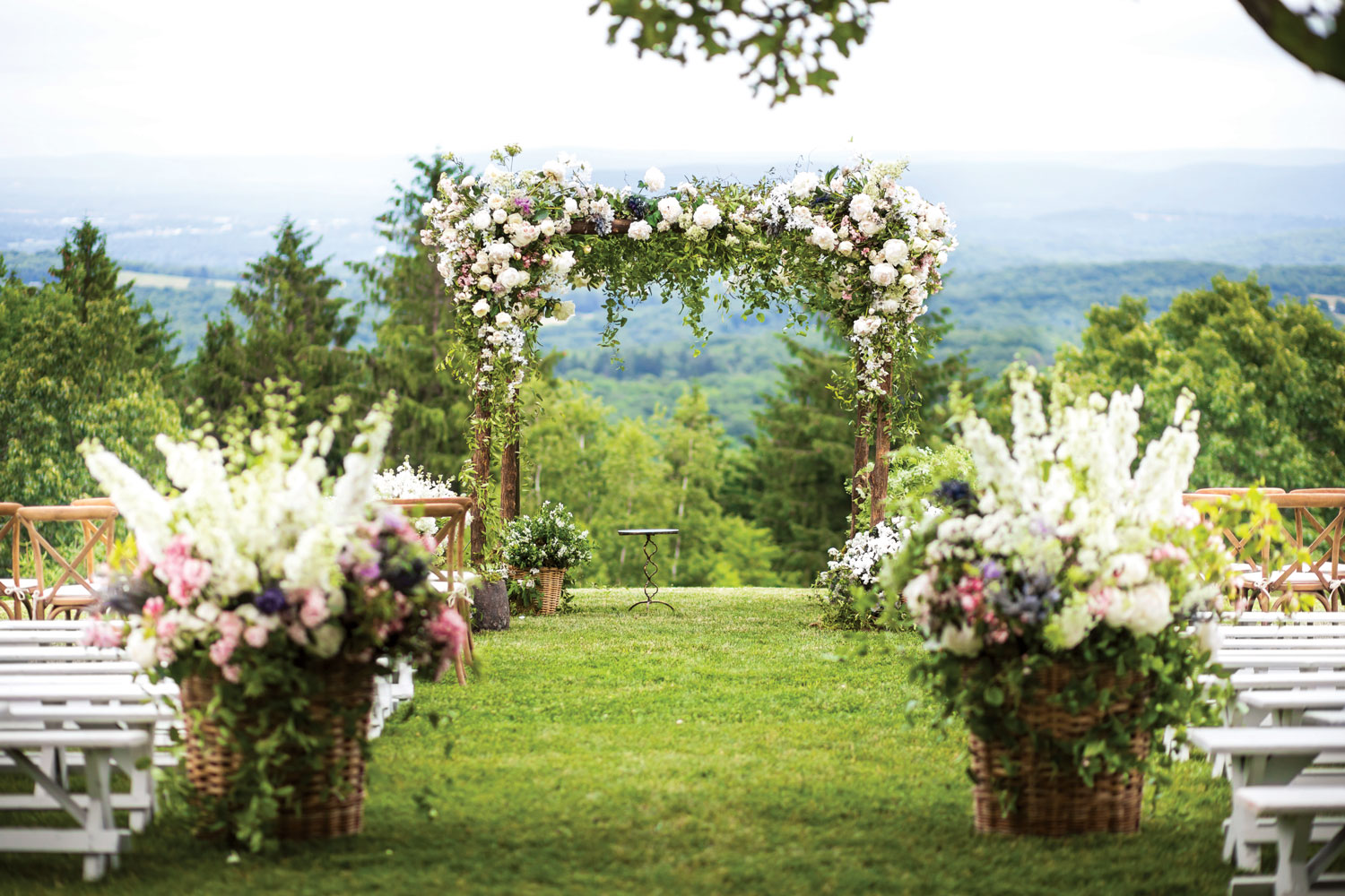 Inside Weddings magazine summer 2019 issue preview outdoor wedding ceremony grassy pretty view countryside