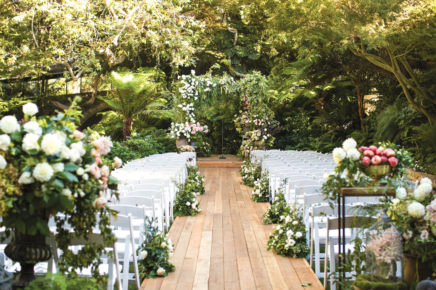 Inside Weddings magazine summer 2019 issue preview outdoor wedding ceremony wood plank aisle greenery